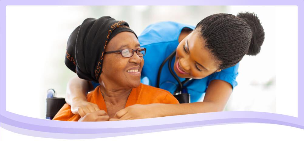 nurse and senior smiling