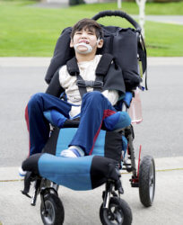 kid in wheelchair smiling